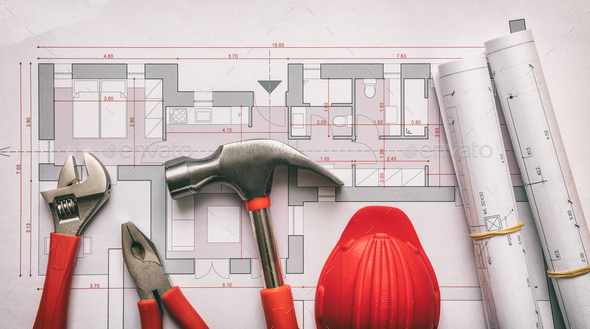 Tools and hardhat on project drawings. Architect engineer office desk. - Stock Photo - Images