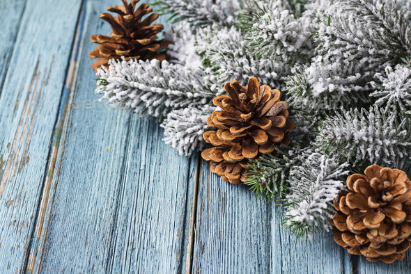 Christmas or New year festive background with pine cones - Stock Photo - Images