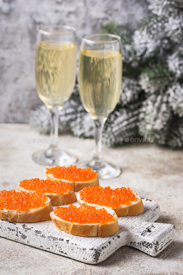 Toasts with red salmon caviar and champagne - Stock Photo - Images