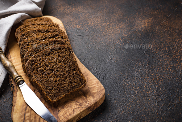 Fresh sliced rye bread on rusty background - Stock Photo - Images