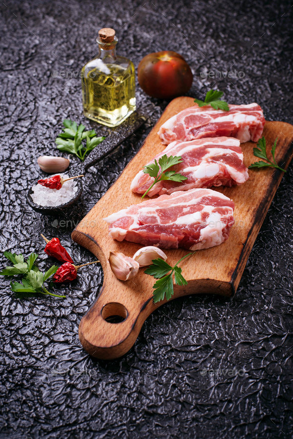 Raw pork meat and ingredients for cooking - Stock Photo - Images
