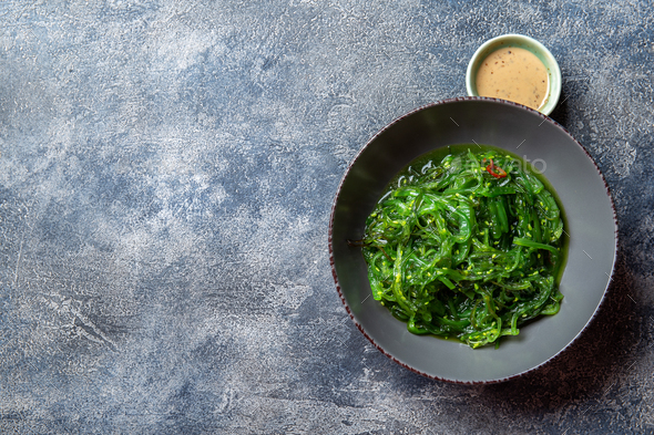 Chuka wakame,  seaweed japanese salad with nuts sauce. - Stock Photo - Images