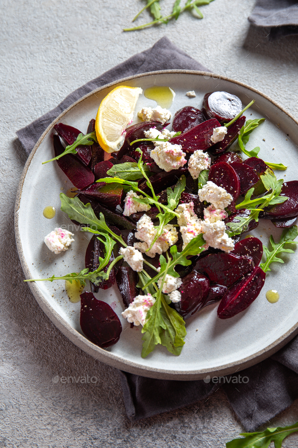 Beetroot cheese salad carpaccio with arugula and lemon. - Stock Photo - Images