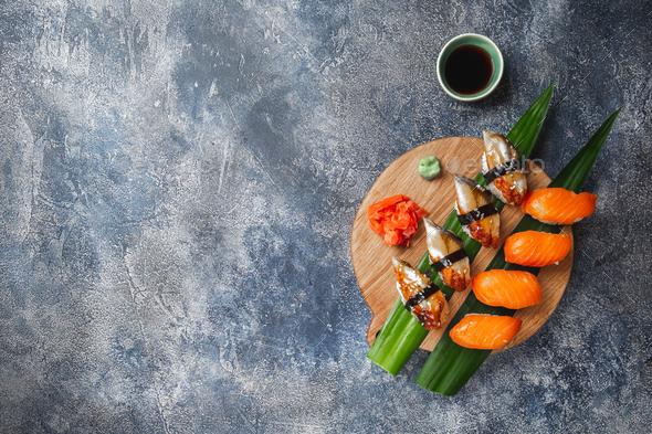 Sashimi sushi set on wooden board. Stone background. Top view. - Stock Photo - Images