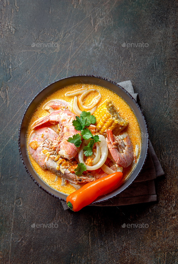Peruvian seafood soup Chupe de Camarones in gray bowl, top view. - Stock Photo - Images