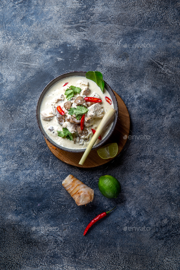 Thai chicken mushroom coconut milk soup Tom Kha Gai in bowl with thai spices - Stock Photo - Images