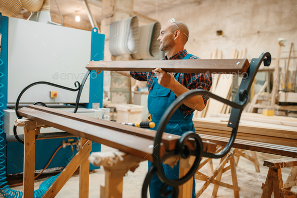 Carpenter, wooden bench manufacturing, joiner job - Stock Photo - Images
