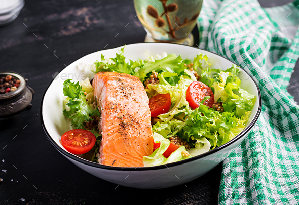 Baked salmon fillet with fresh vegetables salad. - Stock Photo - Images
