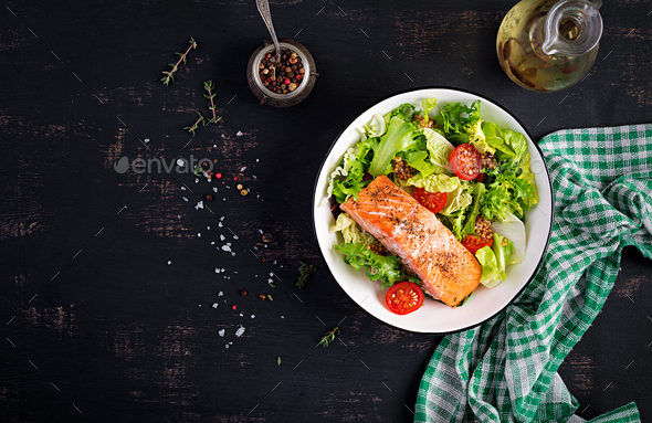 Baked salmon fillet with fresh vegetables salad. Top view, overhead - Stock Photo - Images