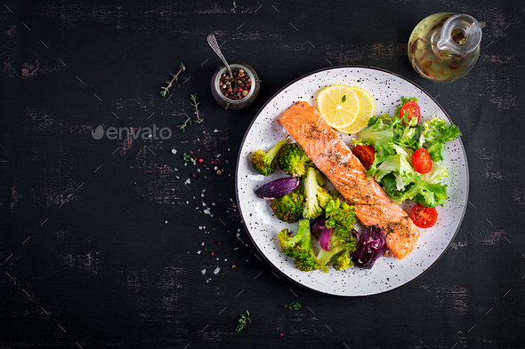Baked salmon fillet with broccoli, red onion and lemon. Top view, overhead - Stock Photo - Images