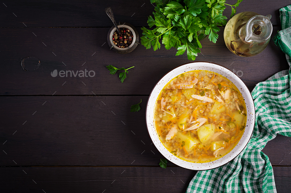 Chicken soup with potatoes and buckwheat. Top view - Stock Photo - Images
