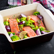Salmon, broccoli and red onion slices are prepared in a baking dish. - PhotoDune Item for Sale