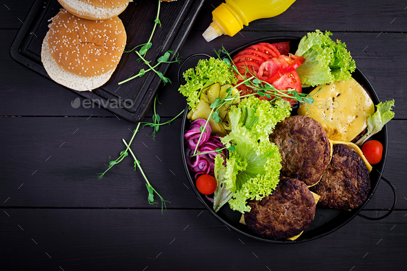 Big sandwich - hamburger burger with beef,  tomato, cheese, pickled cucumber and red onion. - Stock Photo - Images