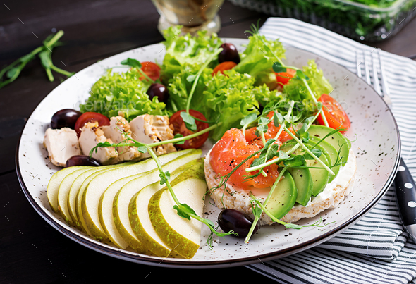 Healthy breakfast. Sandwiches with cream cheese,  salmon, avocado and slice pear on plate. - Stock Photo - Images