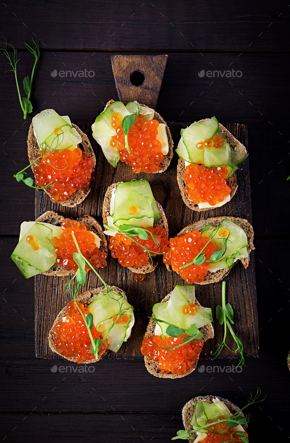 Canape with salmon red caviar. Sandwich for lunch. Delicious food. Top view, overhead - Stock Photo - Images