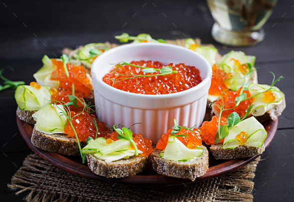 Canape with salmon red caviar. Sandwich for lunch. Delicious food. - Stock Photo - Images