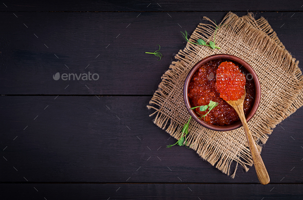 Salmon red caviar in bowl. Delicious food. Top view, overhead - Stock Photo - Images