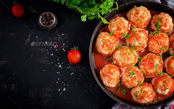Meatballs in sweet and sour tomato sauce. Top view, overhead - Stock Photo - Images