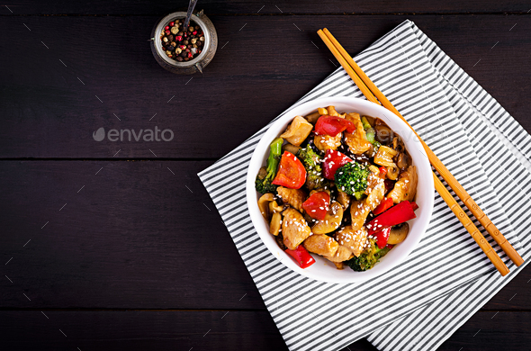 Stir fry with chicken, mushrooms, broccoli and peppers. Chinese food. Top view, overhead - Stock Photo - Images