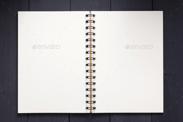 notepad or notebook paper at black wooden background - Stock Photo - Images