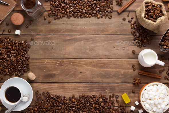 cup of coffee and beans on wooden background - Stock Photo - Images