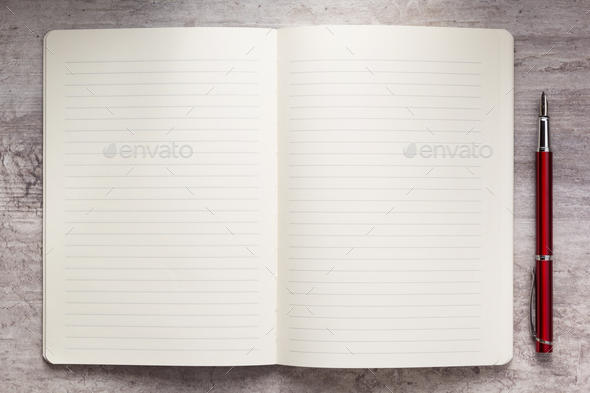 notepad or notebook paper at stone background - Stock Photo - Images