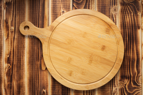 pizza cutting board at rustic wooden plank background - Stock Photo - Images