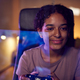 Teenage Girl With Game Pad Sitting In Chair and Gaming At Home With Screen Reflection - PhotoDune Item for Sale