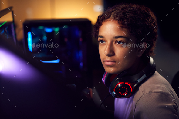 Teenage Girl With Headset Gaming At Home Using Dual Computer Screens - Stock Photo - Images