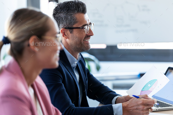 Smiling business team listening her partners on coworking space. - Stock Photo - Images
