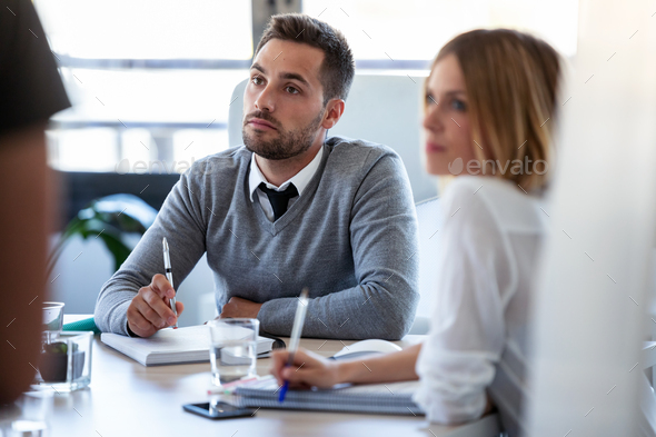 Concentrated business team listening they partners on coworking space. - Stock Photo - Images