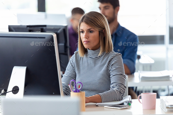 Software developer working with computer in the modern startup office. - Stock Photo - Images