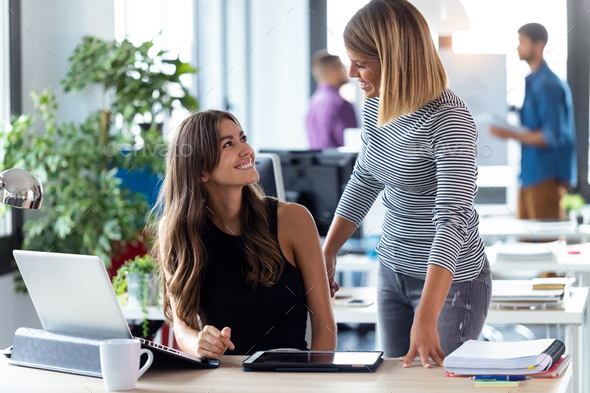 Two business young women working together with digital tablet in the modern startup office. - Stock Photo - Images