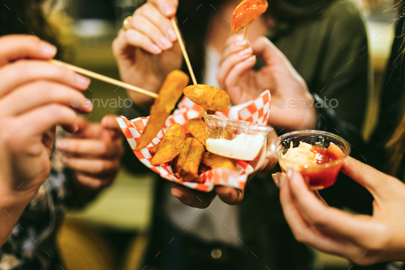 Group of friends visiting eat market in the street. - Stock Photo - Images