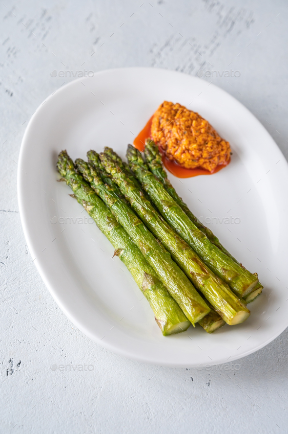 Fried asparagus with romesco sauce - Stock Photo - Images