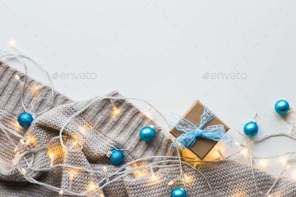 Knitted plaid with a garland on a white background - Stock Photo - Images