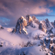Snowy mountain peaks in fog  and blue sky with clouds at sunset - PhotoDune Item for Sale