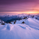 Colorful red sky and sunlight over the snow covered mountains - PhotoDune Item for Sale