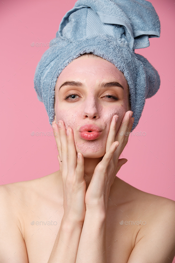 Beauty treatment - woman applying clay face mask - Stock Photo - Images