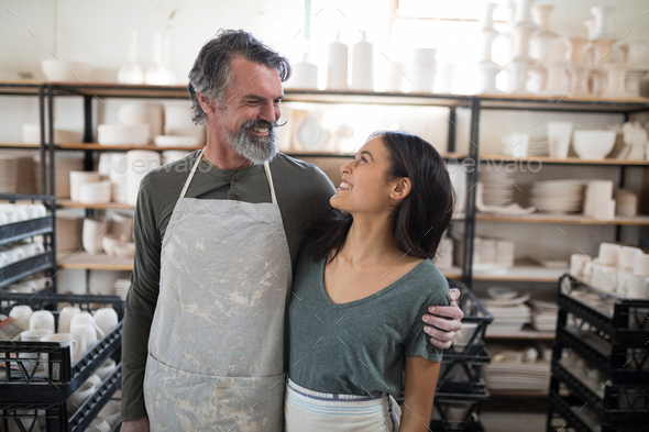Smiling potter colleagues looking at each other - Stock Photo - Images