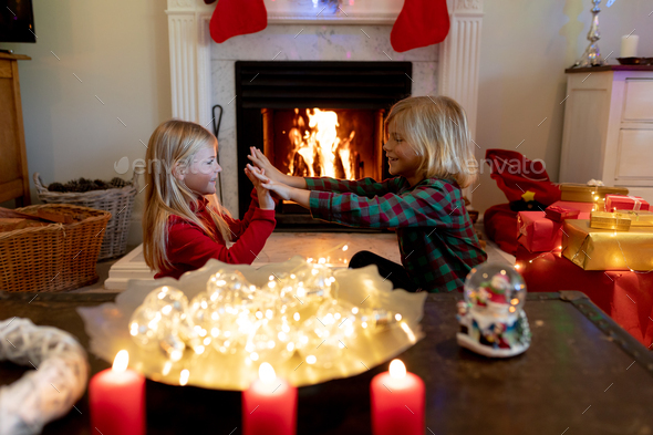 Brother and sister at home at Christmas time - Stock Photo - Images