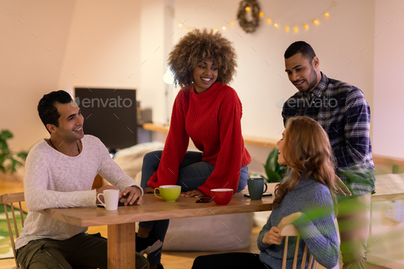Millennial adult friends socialising together at home - Stock Photo - Images