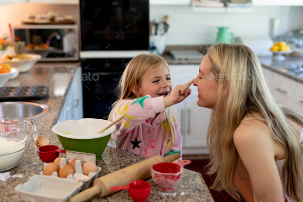 Family making Christmas cookies at home - Stock Photo - Images