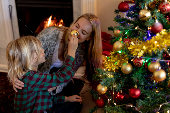 Family at home at Christmas time - Stock Photo - Images