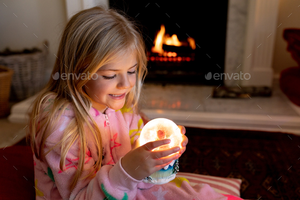 Girl at home at Christmas time - Stock Photo - Images