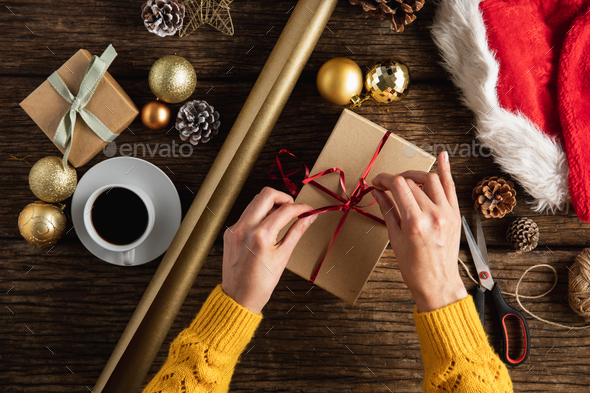 Hands wrapping christmas gifts - Stock Photo - Images