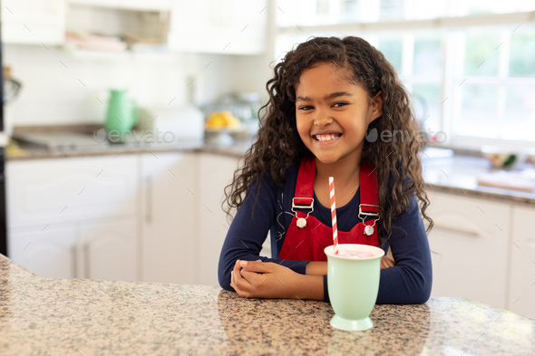 Girl in a kitchen at Christmas time - Stock Photo - Images