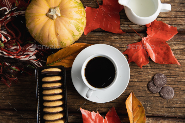 Autumn flat lay with hot drink and treats - Stock Photo - Images