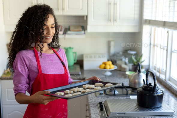 Woman making Christmas cookies - Stock Photo - Images