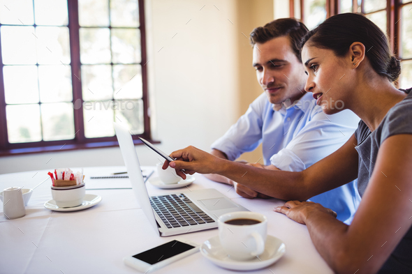 Business people discussing on laptop - Stock Photo - Images